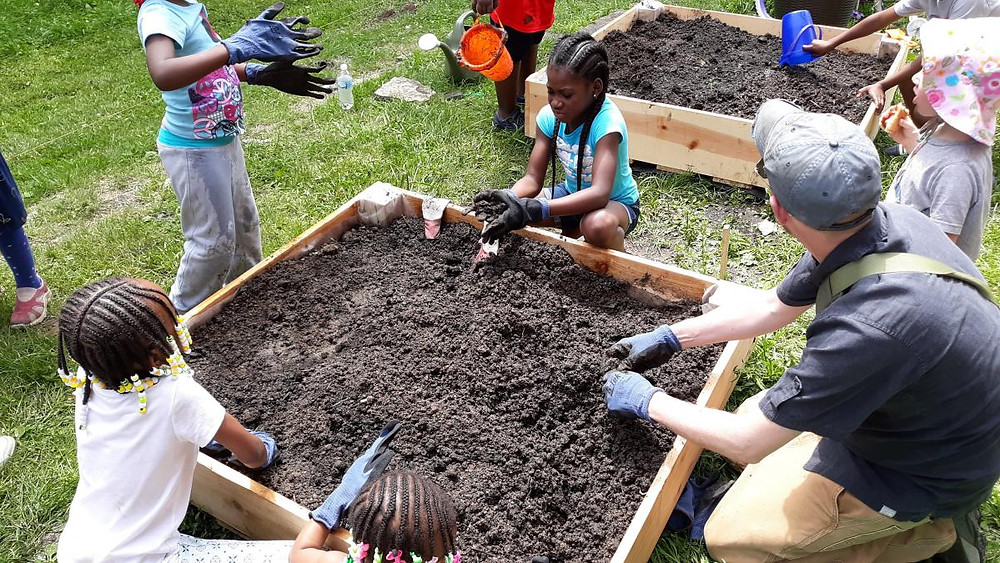 Children & adults volunteer to plant the garden!