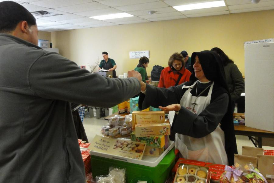 Fraternité Notre Dame sells baked goods at Faith in Place Winter Farmers Markets