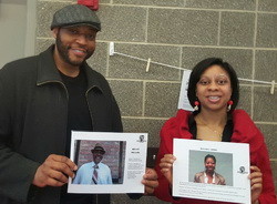 Participants holding up images from the BHM display
