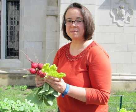 Katie Thomas holds radishes in the Wesley UMC garden.