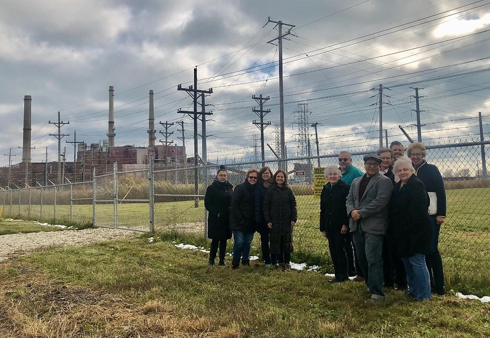 First Presbyterian Church of Libertyville's members with CPLC members posing in front of the old Waukegan Coal Plant owned by NRG Energy during a driving tour in 2019.