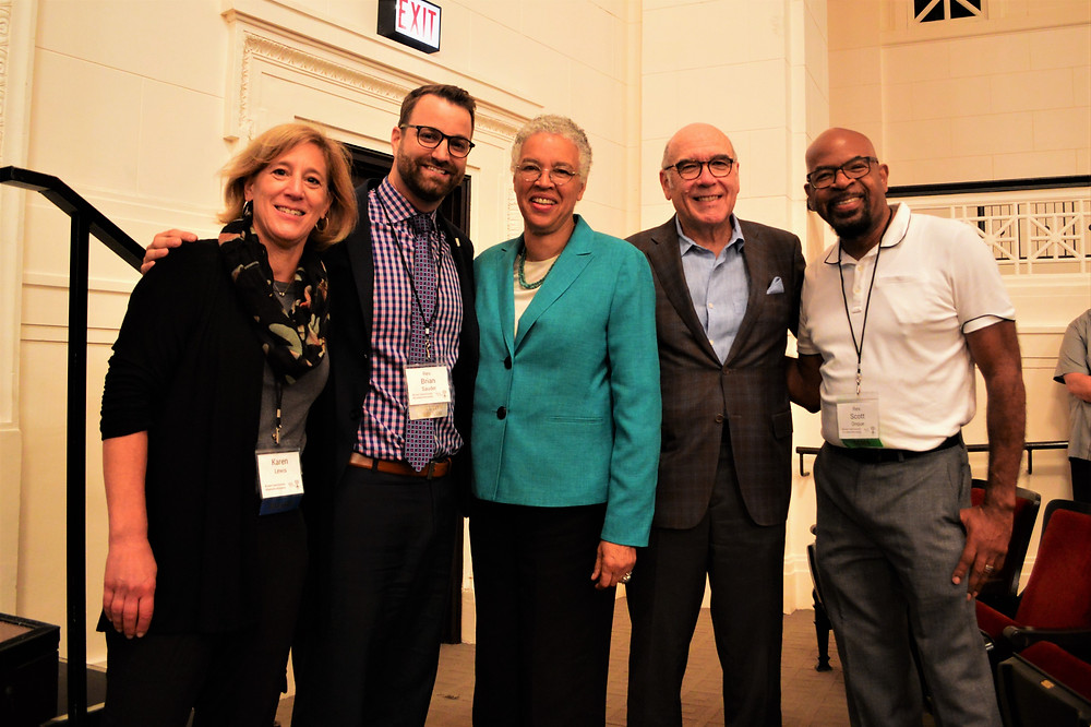 Our team posing with President Toni Preckwinkle and Field Museum CEO Richard Lariviere.