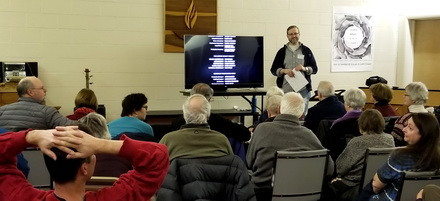 Dan Huntsha leads a film discussion at the Unitarian Church of Hinsdale in 2018.