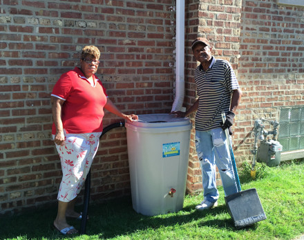 Advocate UCC members pose with their new rain barrel