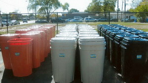 Rain barrels lined up for distribution at Trinity All Nations!!