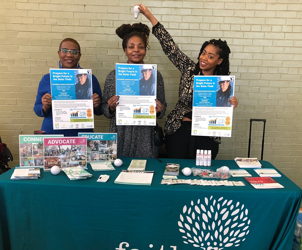 Faith in Place staff Veronica Kyle, Princess Harris, and Isioma Odum educate Bronzeville residents about smart energy and workforce development for clean energy jobs.