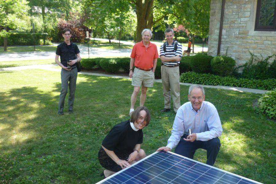 Rev. Daphne Cody & parishioners with a solar panel
