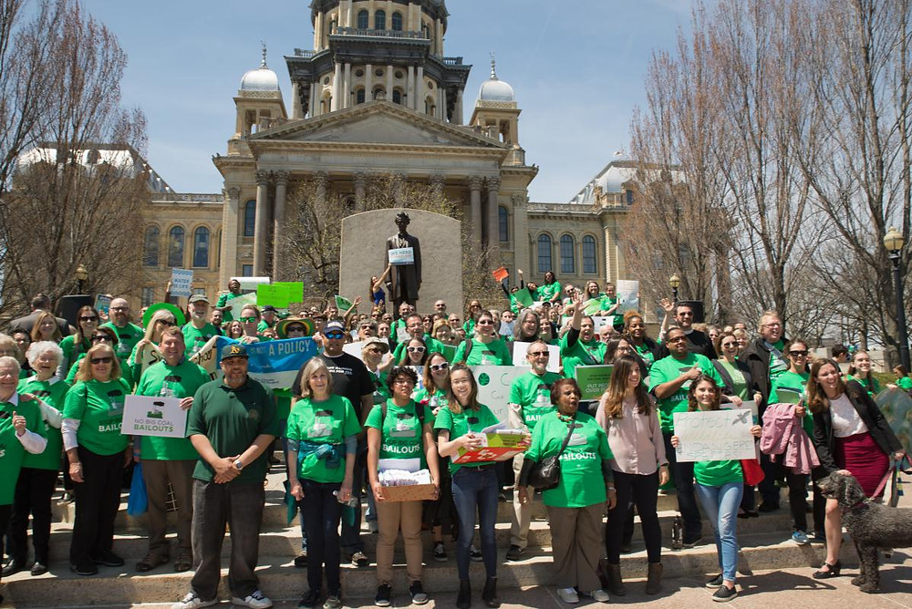 300 Climate Advocates rally in front of the Lincoln statue at the IL State Capitol!