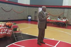 Rev. Ozzie Smith speaks at the program.