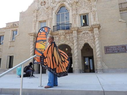 Migration & Me Program Coordinator, Rev. Debra Williams, wears butterfly wings for the celebration!
