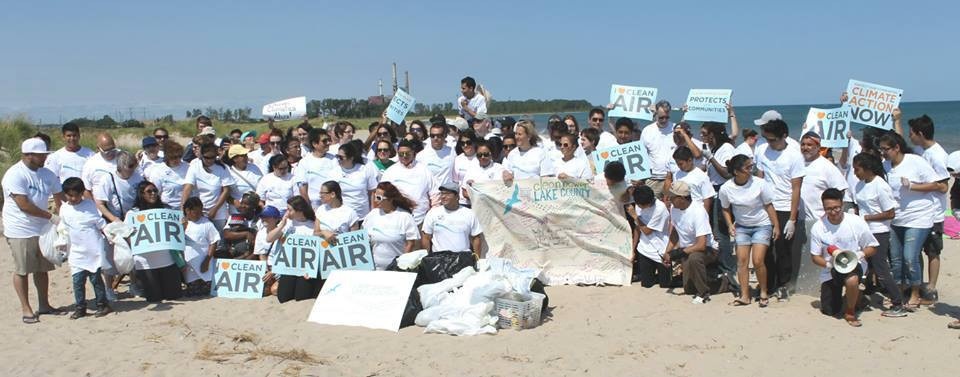CPLC and Faith in Place advocates pictured on the beach in 2015 with the Waukegan coal plant in the background.