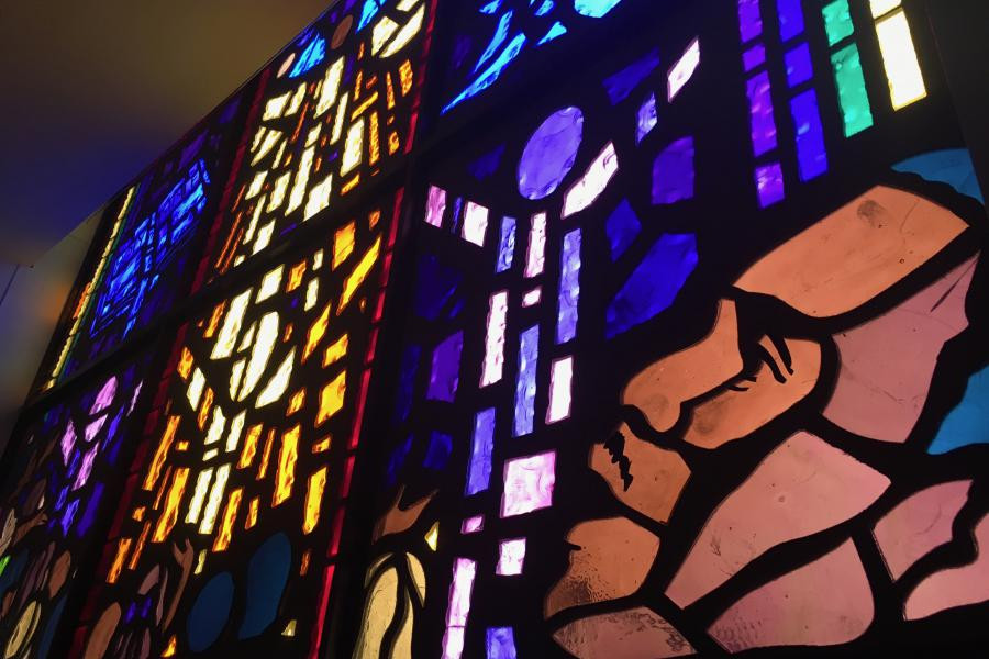 Stained glass prominently features Martin Luther King, Jr. to commemorate his stay in North Lawndale.