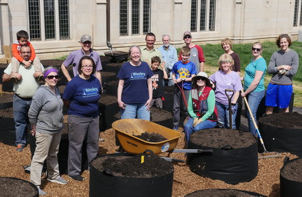 Volunteers set up the innovative garden at Wesley UMC in Urbana.
