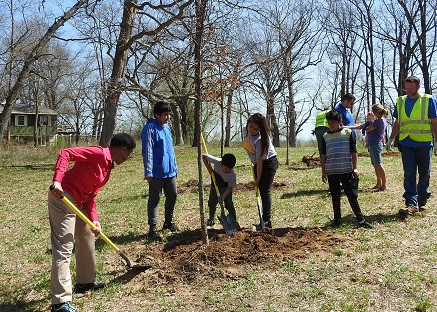 Connecting with the Earth by planting trees in Waukegan