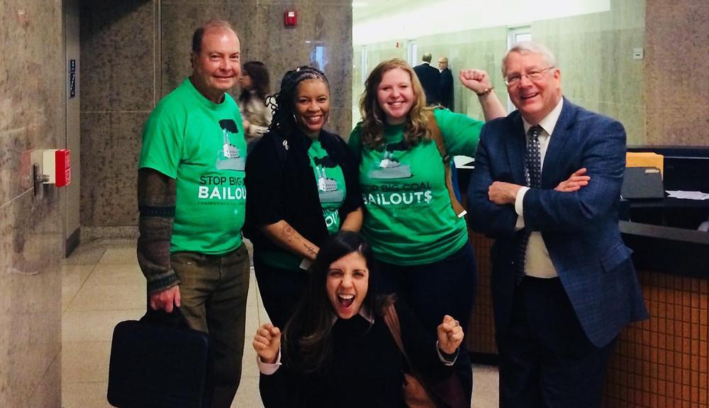 Karen Winters & Kate Stell meet their legislator in the hallway.