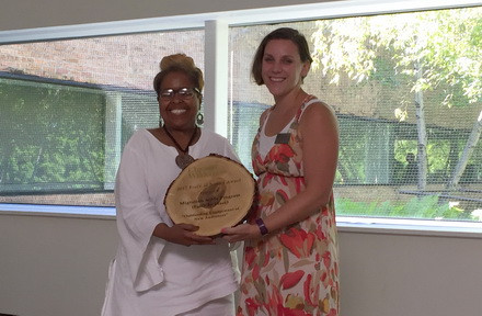 Rev. Debra Williams, receives the Force of Nature Award from Chicago Wilderness
