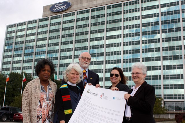 Christina Krost joins other Interfaith Power & Light members at Ford's Headquarters.