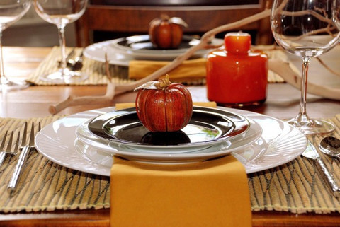 Set table for Thanksgiving with a pretty plate