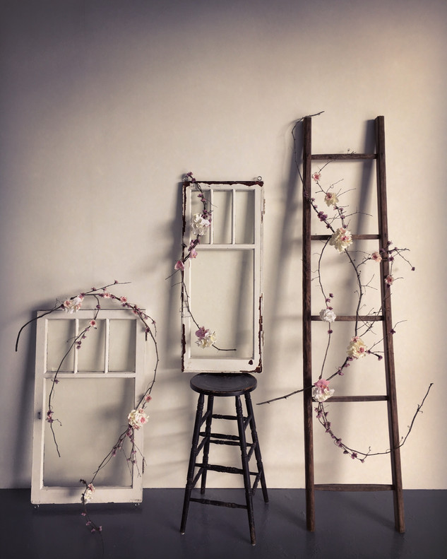 I brought together some of my antique pieces and created this garland from some grapevine I found on the side of the road. For me it envokes magic.
