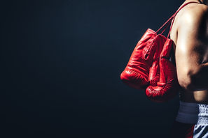 pair-of-red-gloves-on-the-fighters-back-