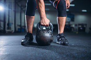 male-athlete-prepares-for-exercise-with-
