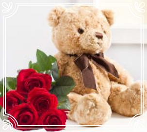 mazzo di rose rosse per san valentino con tenero orsetto peluche
