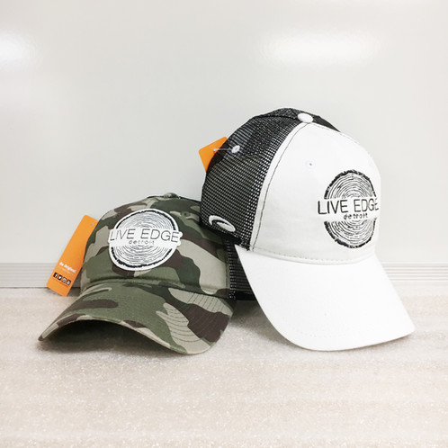 f382ee42 Limited Edition Live Edge Detroit Snap-Back Trucker Hats. Black mesh back  with adjustable snap closure for sizing. White has logo embroidered right  on the ...