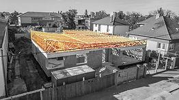 MiTek típusú szeglemezes tetőszerkezet rácsos tatókból lapos tetős házra.