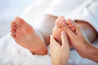 Feet having reflexlogy massage