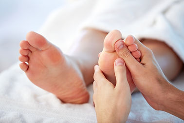 Foot treatment using Reflexology points to access various parts of the body