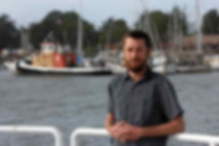 Humboldt Cannabis Tours owner Matt Kurth with harbor in background