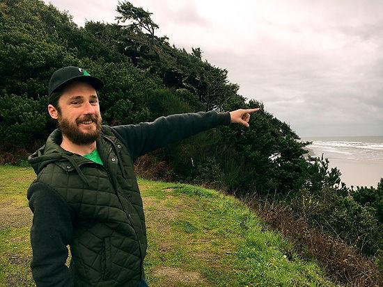 Humboldt Cannabis Tours founder Matt Kurth standing on cliff over ocean