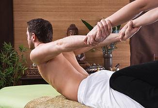 Thai woman making massage to a man.jpg