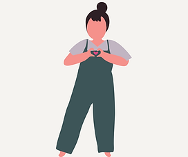 A woman in overalls holding her hands together in the shape of a heart.