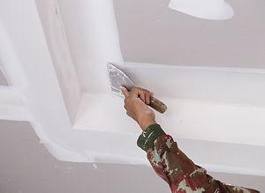 Worker-doing-drywall-repair.jpg