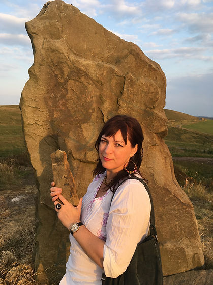 Kathryn Monks at a standing stone on the beautiful East Lancs Moors holding a minature standing stone, future sculpture.