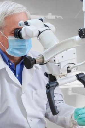Using Dental Microscope.JPG