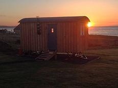 Hut outside sunset view.jpg