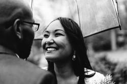 bride smiling under umbrella