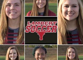 Six varsity girls, coach win All Region honors