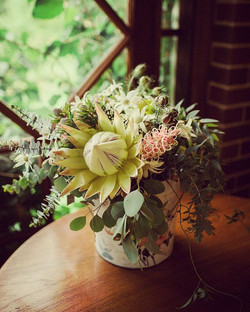The bride's native bouquet sitting in the bucket waiting for its moment #daisysdaisies #canberraflor