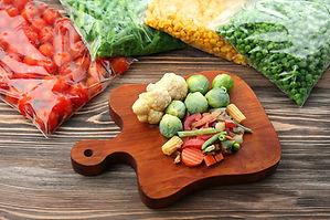 Frozen vegetables on wooden board.jpg