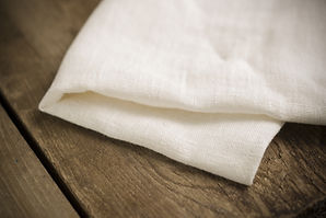 Folded white cotton fabric or linen on w