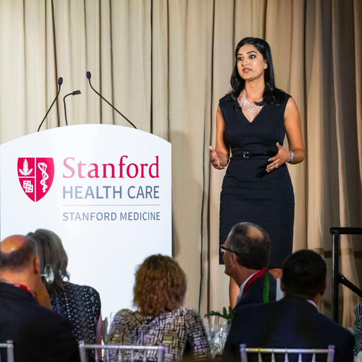 Parul speaking at the grand opening of the new Stanford Hospital in 2019. Photo Credit: Devlin Shand for Drew Altizer Photography.