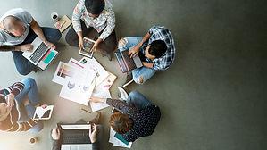 business-team-sitting-floor.jpg