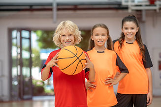 kids-sportswear-standing-with-ball-looki