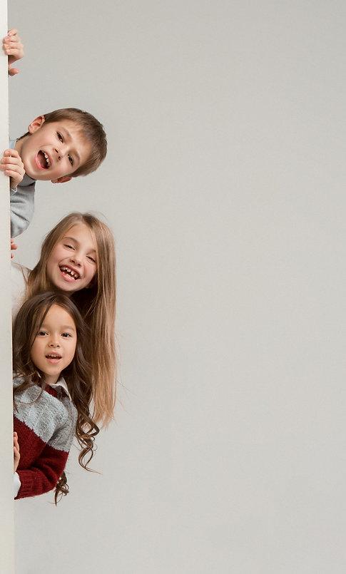 banner-with-surprised-children-peeking-e
