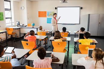 teacher-giving-lesson-her-students.jpg