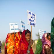 Ekta-Parishad. Woman with placard