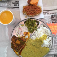 Delicious Madras Cafe vegetarian thali and the famous mango lassi